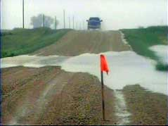 edmunds county flood water over road gravel rain wet