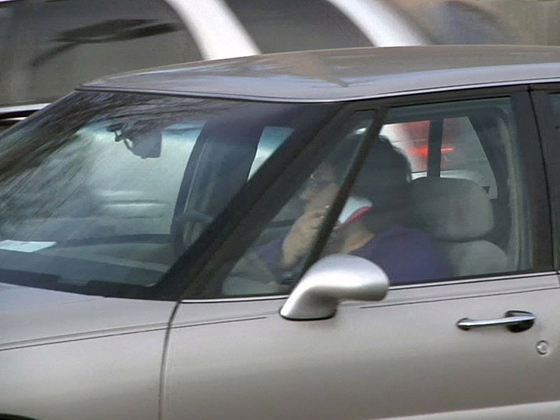 woman driving while talking on cell phone huron