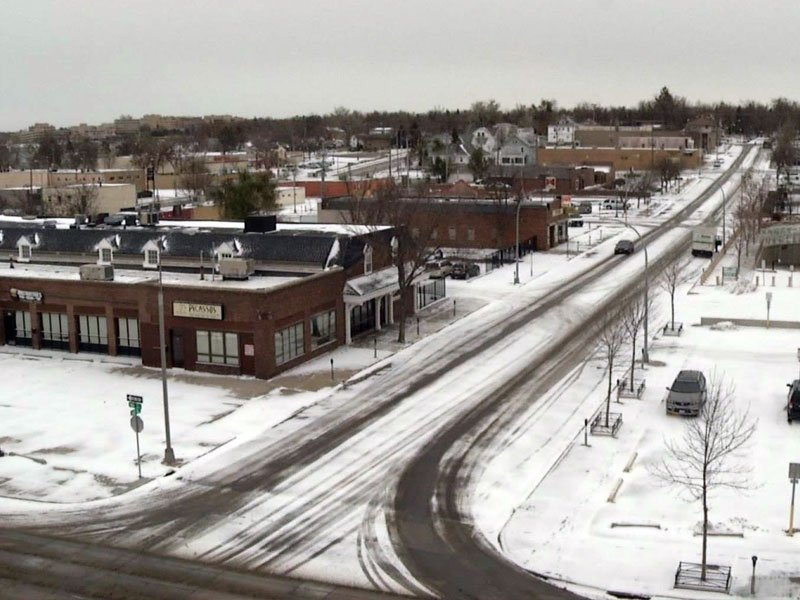 light snow covers parts of keloland, snow in downtown sioux falls